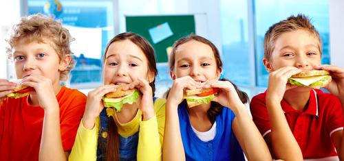kids eating snack 131916308